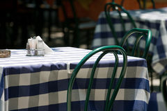 Table in a street cafe. Empty table with chairs in a street cafe covered by blanket royalty free stock image