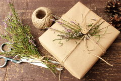 Table in a studio with festive wrapped gift box Stock Images