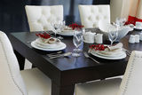 The table is styled and beautifully set for dinner Royalty Free Stock Photos