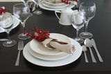 The table is styled and beautifully set for dinner Royalty Free Stock Images