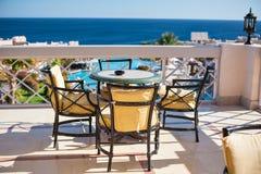 Table on a summer area overlooking the sea Stock Photo