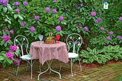 Table in summer garden Royalty Free Stock Photography