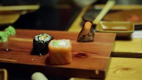 A table at sushi bar stock video footage