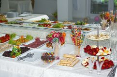Table with sweets and food Royalty Free Stock Photography