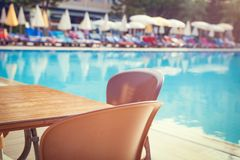Table with swimming pool view on resort hotel. Stock Photography