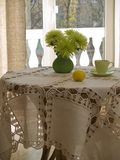 Table with table cloth. Table with table-cloth in interior in sunny day Royalty Free Stock Image