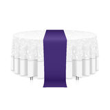 Table with tablecloth. Isolated blank round table with white tablecloth and a purple ribbon for celebration isolated Stock Photo