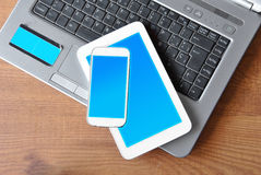 Table with tablet, phone and PC Stock Photo