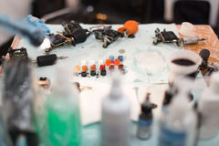 Table of tattoo master. Work place of tattoo master Royalty Free Stock Photos
