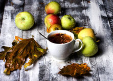Table tea apple and rain Royalty Free Stock Photography