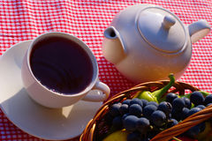 Table With Tea And Basket Royalty Free Stock Photography