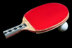Table tenis ball and the racket. Table tenis racket and ball on the black background Stock Photos