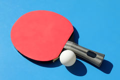 Table tennis. Red racket and white ball Stock Photo