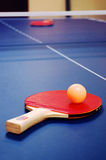 Table tennis. A pair of red table tennis paddles on a table stock photos
