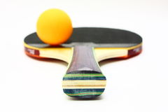 Table Tennis. Ping pong or table tennis paddle and ball over white background Stock Images