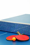 Table tennis. Ping pong paddles and ball Royalty Free Stock Images