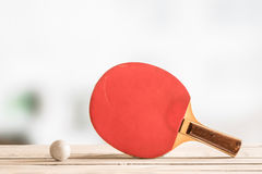 Table tennis bat with a ball Royalty Free Stock Images