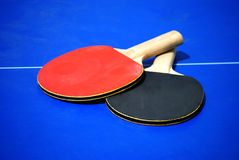 Table Tennis Bats. On blue table Royalty Free Stock Photo
