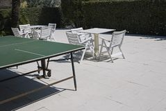Table tennis in a beach club stock image
