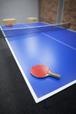 Table tennis. Blue table tennis table with red racket Royalty Free Stock Photography