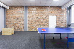 Table tennis. Blue table tennis table with red racket Royalty Free Stock Images