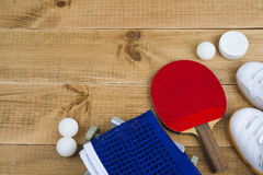 Table tennis equipment on wooden texture background with copy space Stock Image