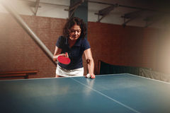 Table tennis, female player with racket and ball Royalty Free Stock Photos