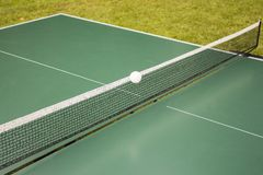 Table tennis, ping-pong table and the white ball on a green table. Stock Images