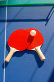 Table tennis ping pong two paddles and white ball Royalty Free Stock Photos