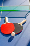 Table tennis ping pong two paddles and white ball Royalty Free Stock Photography