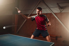 Table tennis, player in action, ball with trace Royalty Free Stock Photo