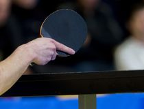 Table tennis player in action, close up. Individual sport royalty free stock photography
