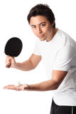 Table tennis player in front of white background. Young table tennis player wearing a white tshirt with black shorts. White background stock images