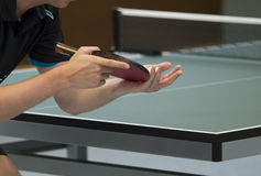 Table tennis player serving Stock Photography
