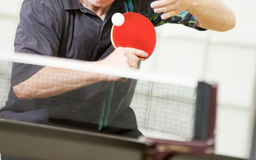 Table tennis player serving Stock Images