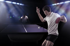 Table tennis player serving. Table tennis player is making a service Stock Photos