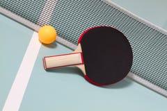 Table tennis racket and ball Stock Photos