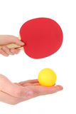 Table tennis racket with orange ball Stock Photos