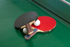Table tennis rackets and ball Stock Photos