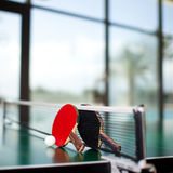 Table tennis rackets and ball Royalty Free Stock Photos