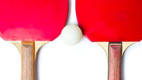 Table tennis rackets and a ball isolated Stock Photography
