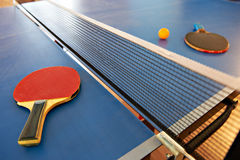 Table tennis rackets and orange ball Stock Photos
