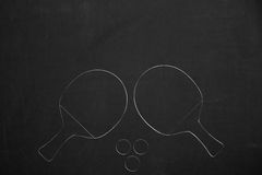 Table tennis rackets with three balls drawed with chalk on a dar Stock Photos