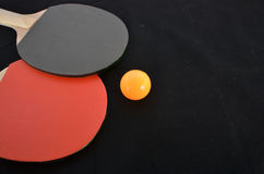 Table tennis rackets and yellow ball for playing Royalty Free Stock Photography