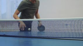 Table tennis serve concept. slow motion video. blurred focus man playing training serves ball in table lifestyle tennis stock video
