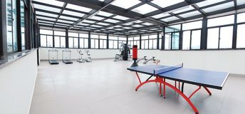 Table tennis table in gym Royalty Free Stock Photography
