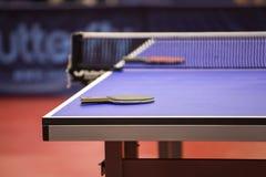 Table tennis table with racquet Stock Photos