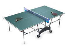 Table tennis with tennis rackets and a ball on it. Stock Photography