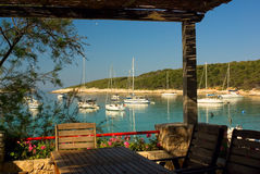 Table on terrace of exotic island beach restaurant. Near Hvar, Croatia Stock Photo