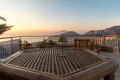 Table on the terrace overlooking the Bay of Naples and Vesuvius. Sorrento. Italy Royalty Free Stock Image